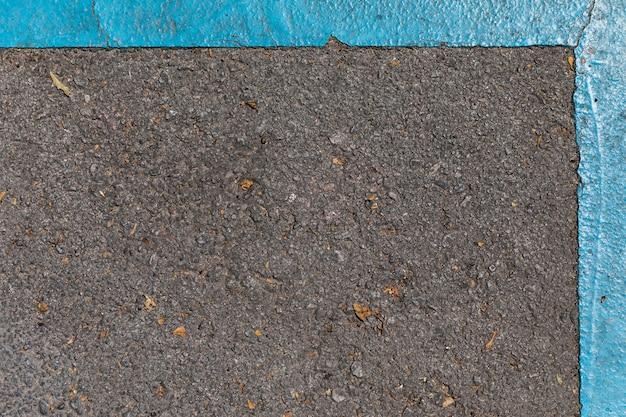 Textura de pavimento com sinais de trânsito