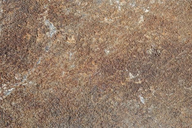 Textura de pedra natural filmada em close-up. fundo para a produção de grés porcelânico e cerâmicas. banco de fotografia