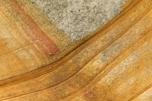 Textura de pedra natural. padrão abstrato em uma rocha.