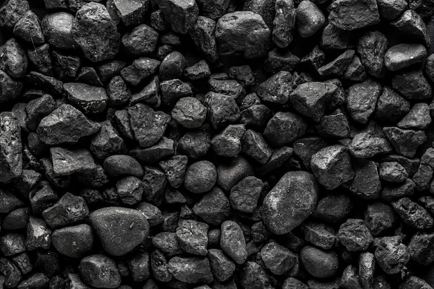 Textura de pedra preta fosca com fundo escuro pedras pequenas