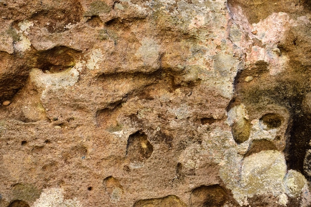 Textura de pedra vermelha e marrom e fundo