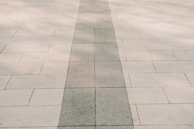 Textura de pedras de pavimentação de pedra cinza em close-up