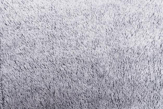 Textura de pelúcia cinza peluda, plano de fundo