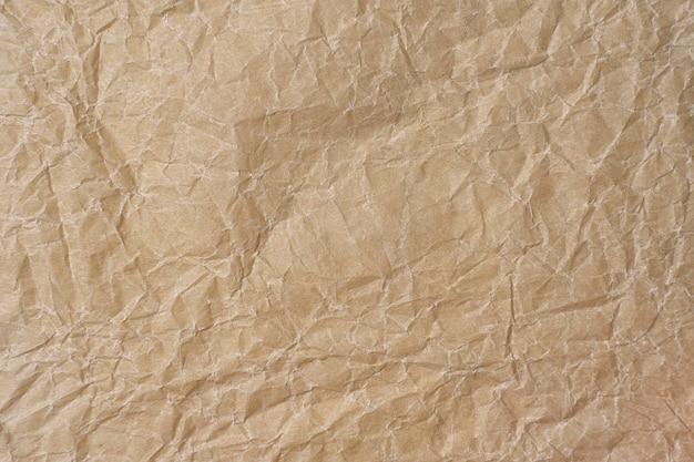 Textura de pergaminho amassado. fundo bege de papel