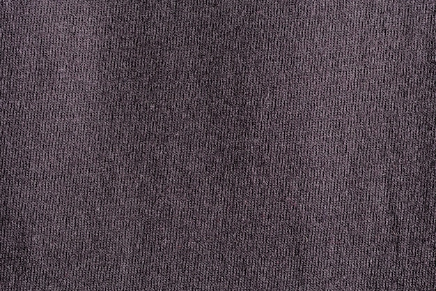 Textura de poliéster de pano de tecido preto e fundo de matéria têxtil.