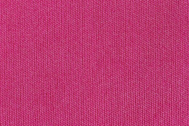 Textura de poliéster de pano de tecido rosa e fundo de matéria têxtil.