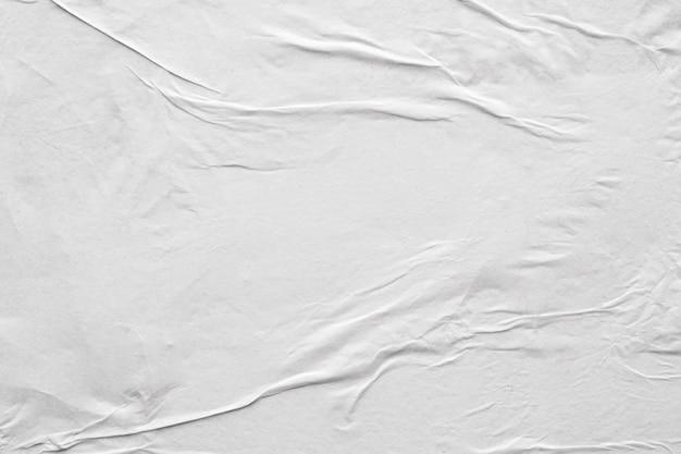 Textura de pôster de papel branco amassado e amassado em branco