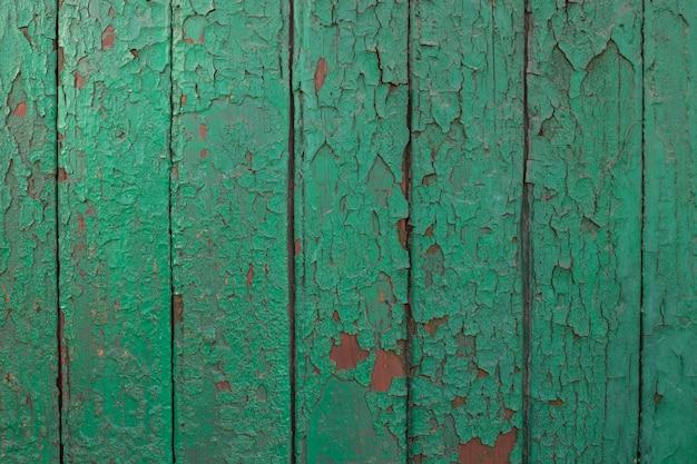 Textura de pranchas de madeira verdes parede de celeiro antigo estilo rústico cerca de madeira pintada em casca verde