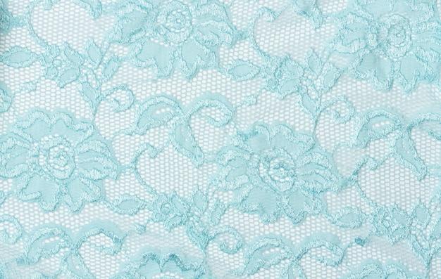 Textura de renda azul com flores. fundo de renda azul com um padrão floral. guipura azul