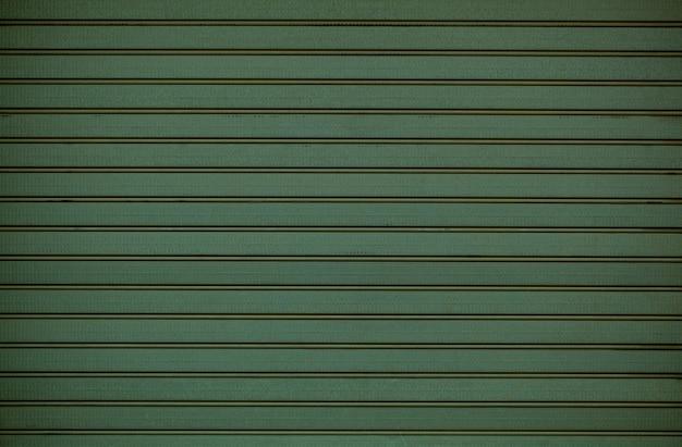 Textura de revestimento de parede de madeira verde com padrão de repetição de linha horizontal em uma exibição de quadro inteiro.