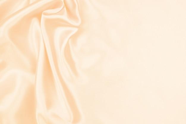 Textura de seda creme linda cetim luxuoso para abstrato, textura de tecido