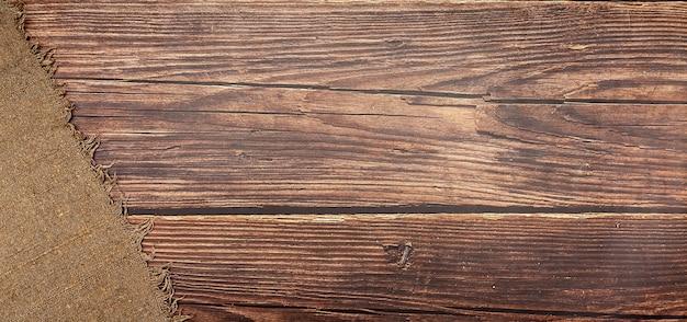 Textura de serapilheira marrom. tecido de vime para o fundo. projeto. sobre um fundo marrom.