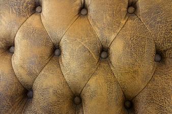 Textura de sofá marrom luz vintage, fundo de sofá de couro marrom padrão