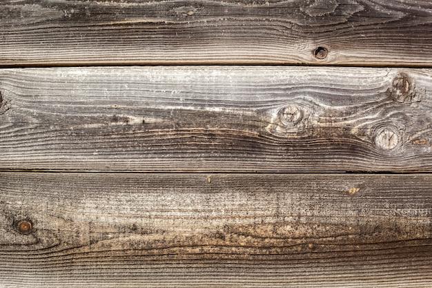 Textura de tábuas de cerca de madeira velha. fundo de textura de madeira