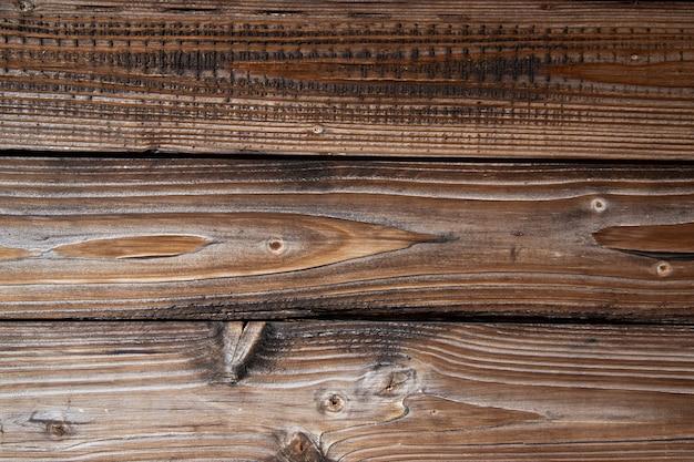Textura de tábuas de madeira velhas da idade marrom envelhecida fundo