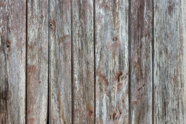 Textura de tábuas rachadas com vestígios de pintura de cortina_