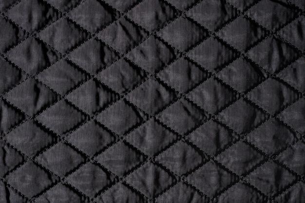Textura de tecido acolchoado preto, fundo de papel de parede