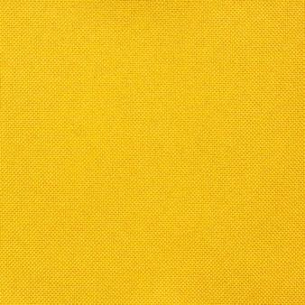 Textura de tecido amarelo sem costura para o fundo