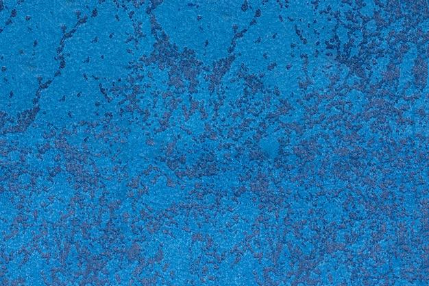 Textura de tecido de camurça azul com um padrão. parede, em branco