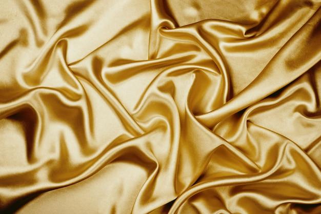 Textura de tecido de cetim de luxo ouro para o fundo