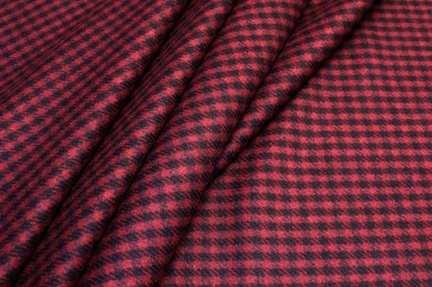 Textura de tecido de lã na cor bordô. pé de ganso.