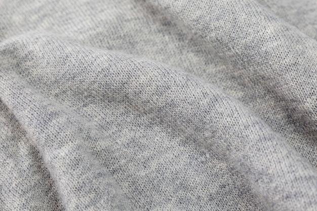 Textura de tecido de malha cinza. fundo. espaço para texto.