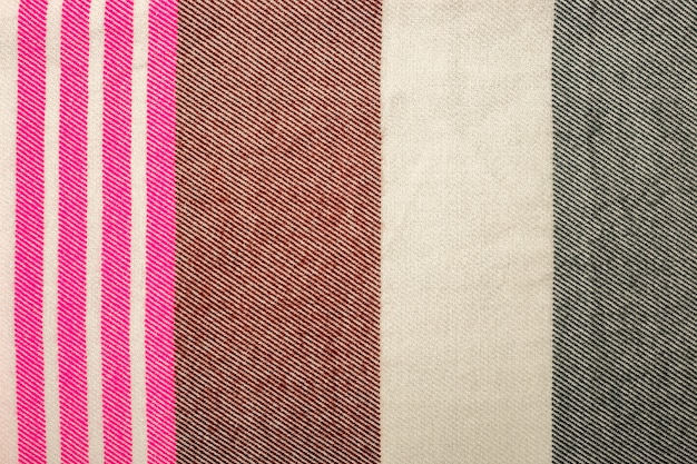 Textura de tecido de malha. fundo quente detalhado feito de fios. tecido de lã natural, fragmento de uma camisola para design. bandeira. camada plana, vista superior.