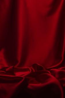 Textura de tecido de seda vermelha ou cetim luxo