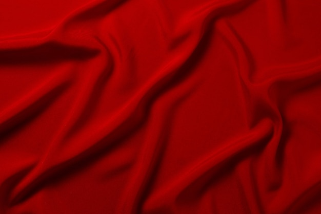 Textura de tecido de seda vermelha ou cetim luxuoso pode ser usada como fundo abstrato. vista do topo