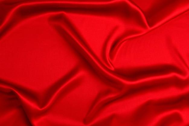 Textura de tecido de seda vermelha ou cetim luxuoso pode ser usada como fundo abstrato