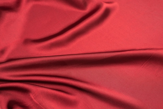 Textura de tecido de seda vermelha ou cetim luxuoso pode ser usada como superfície abstrata