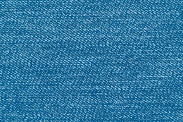 Textura de tecido jeans abstrato, conceito clássico de cor azul