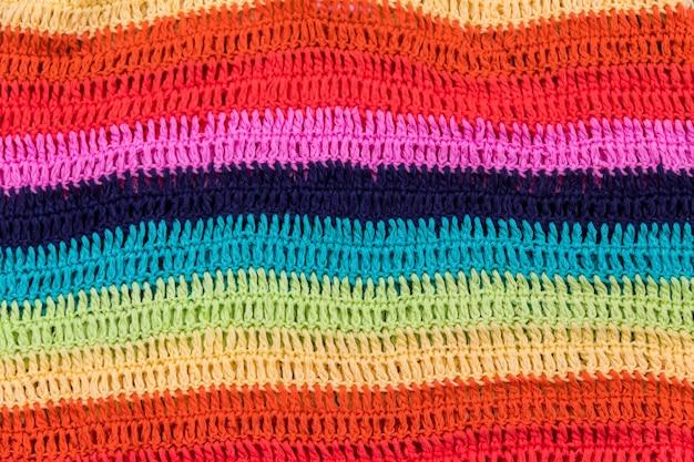 Textura de tecido listrado multicolorido de malha para o fundo