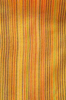 Textura de tecido macro amarelo vibrante poncho mexicano