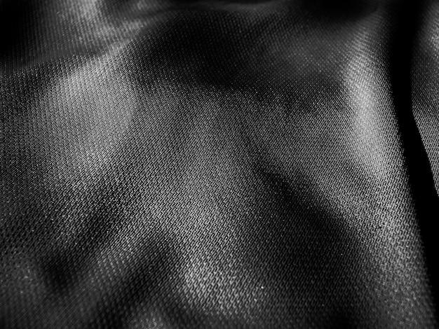 Textura de tecido ondulado. close da textura de tecido preto