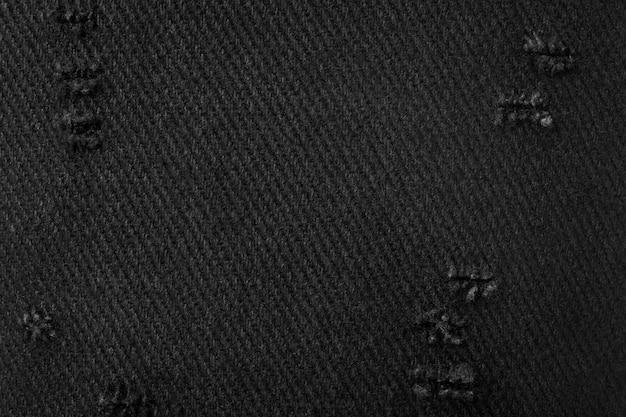 Textura de tecido preto. fundo de material escuro feito de pano. têxtil rasgado.