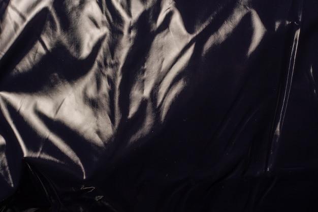 Textura de tecido preto liso brilhante