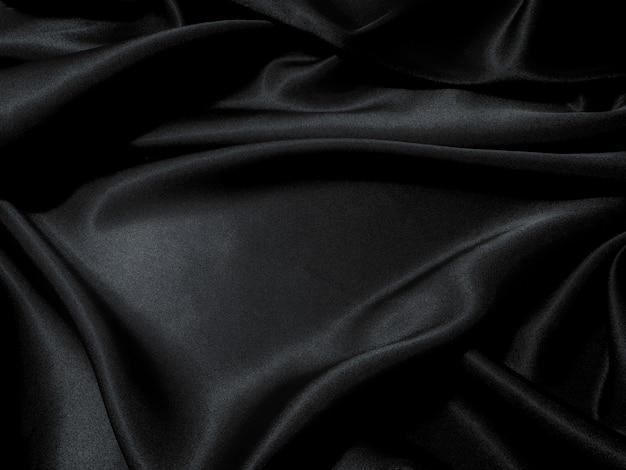Textura de tecido preto, tecido ondulado escorregadio cor preta, textura de pano de cetim de luxo.