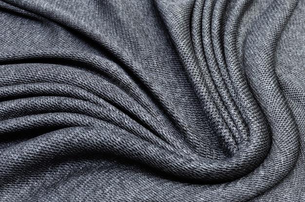 Textura de tecido, textura close-up de tecido preto ou jersey para plano de fundo de web design