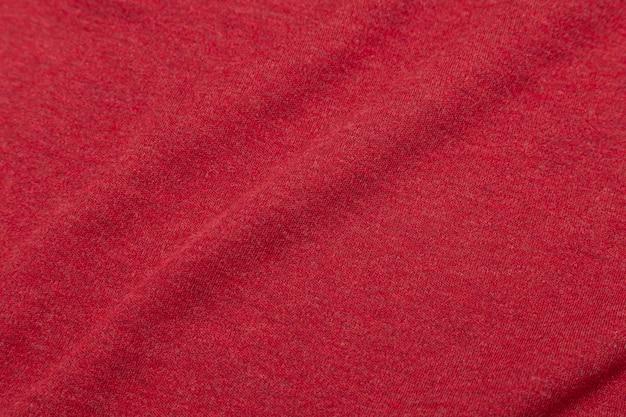 Textura de tecido vermelho, pano de fundo.