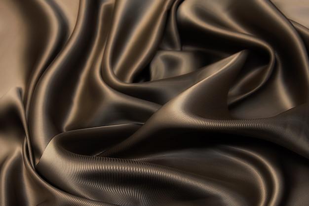 Textura de tecido viscose marrom. plano de fundo, padrão.