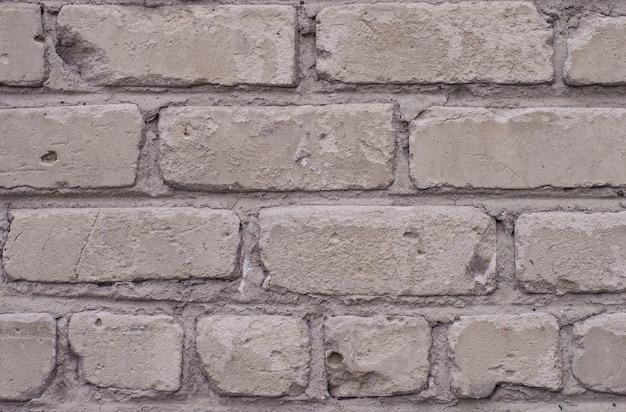 Textura de tijolos antigos na tonalidade cinza da cor