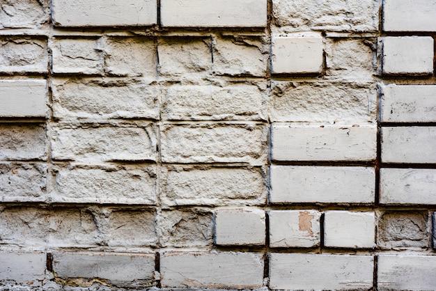 Textura de tijolos com arranhões e rachaduras fundo