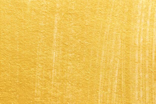 Textura de tinta acrílica dourada em papel branco