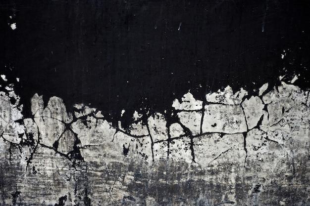 Textura de tinta preta velha descascando fundo parede de concreto