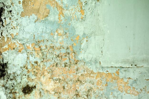 Textura de tinta velha azul sujo é lascar e rachado na parede