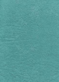Textura de toalha de algodão azul perto do fundo.