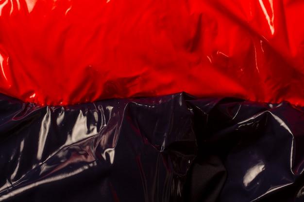 Textura de trama lustrosa lisa vermelha e preta