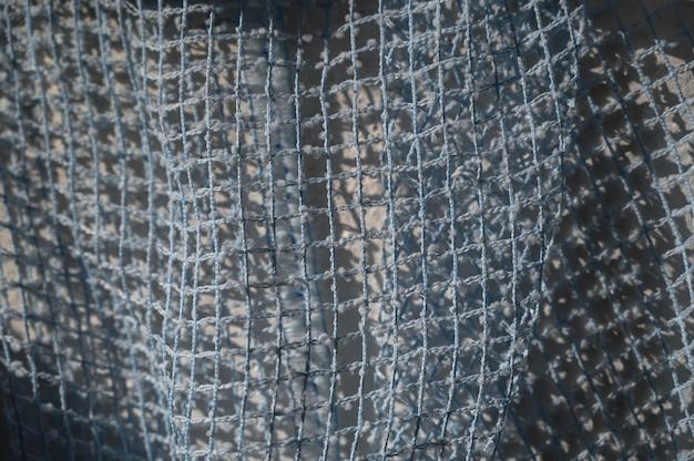 Textura de tule de malha azul close-up