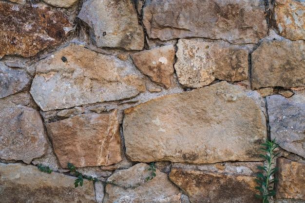 Textura de um antigo muro de pedra natural